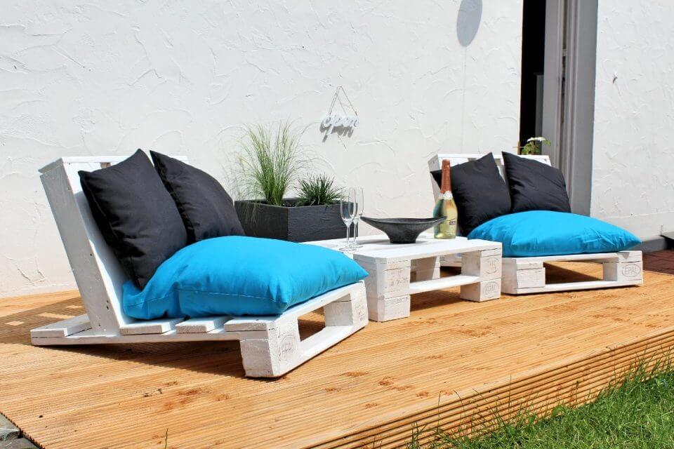 white stained pallet loungers
