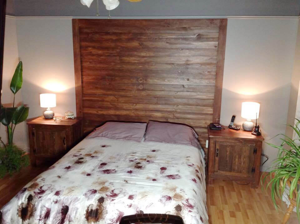 custom wooden pallet headboard wall and nightstands