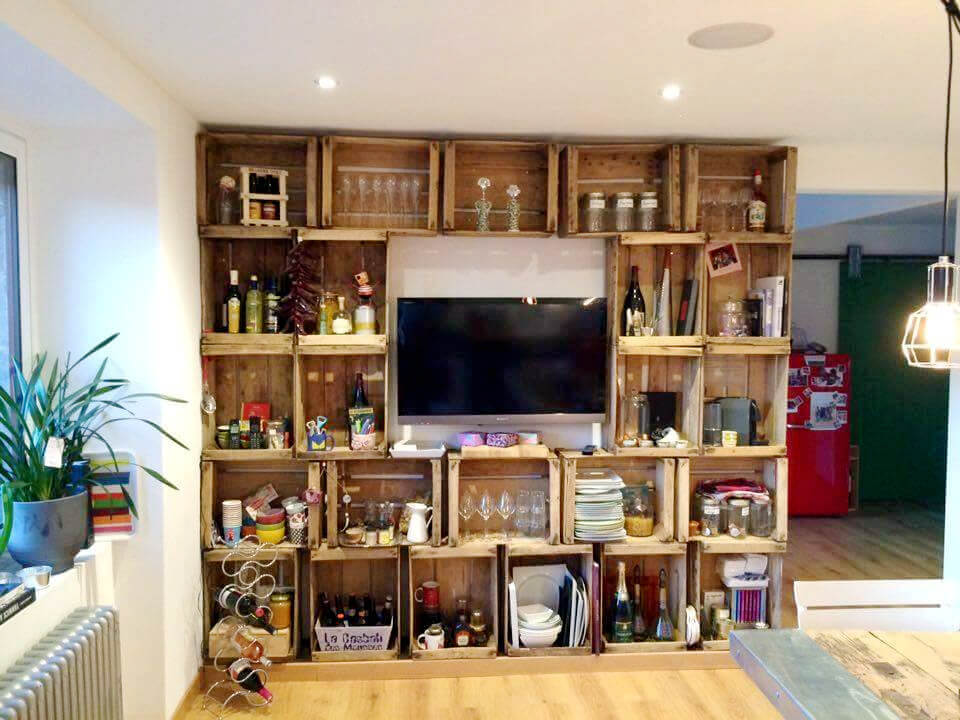 diy pallet media wall with crate style storage shelves