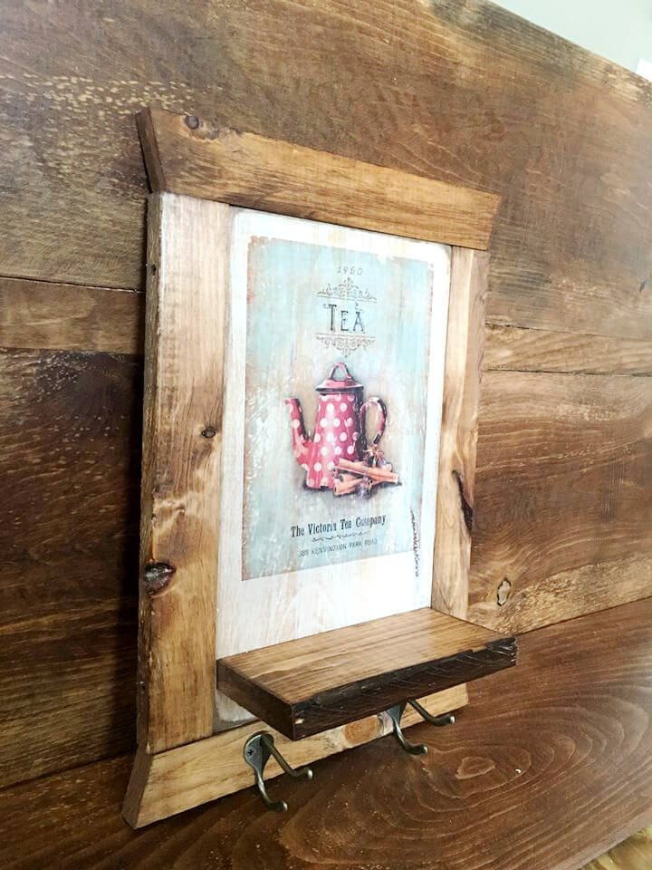 handmade wooden pallet picture frame with shelf and hooks